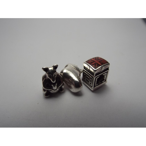 63 - Three 925 silver genuine Pandora charms as a shoe, Kangaroo & telephone box...