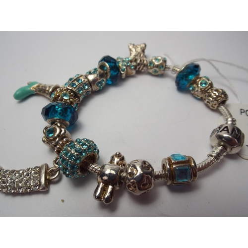 64 - COPY Pandora bracelet with multiple charms & beads...
