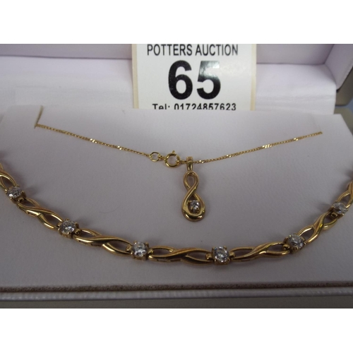 65 - 9ct Gold, stone set Necklace on trace chain plus 9ct gold stone set bracelet in original retail pres...