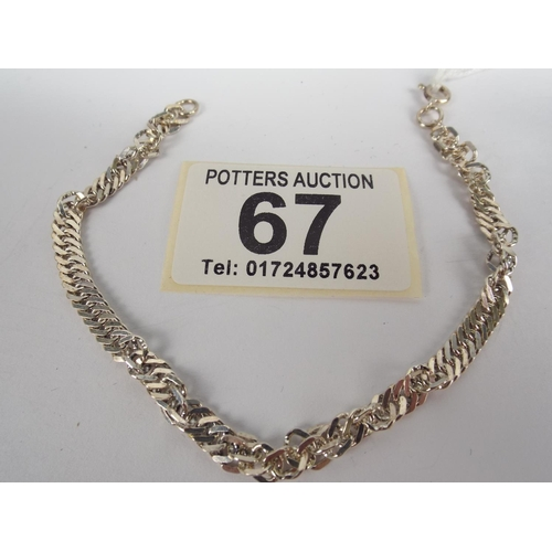 67 - 925 silver bracelet with twist kerb links...