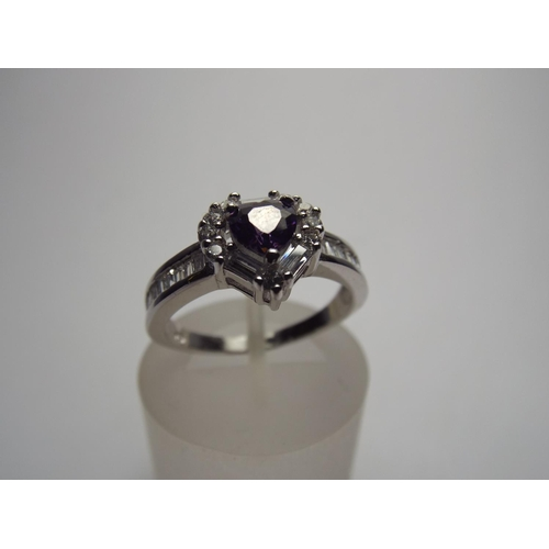 70 - 925 silver ring set with Blue crystal heart shaped stone....