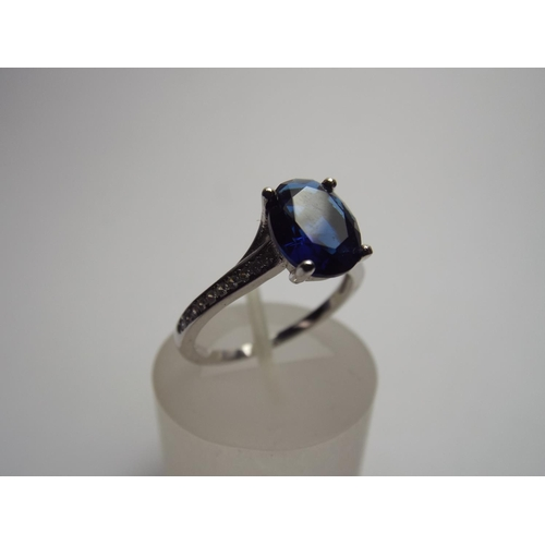72 - 925 Silver ring set with large Blue Crystal...
