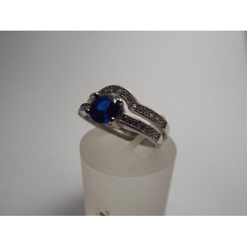 73 - 925 silver two part ring set with blue crystal...