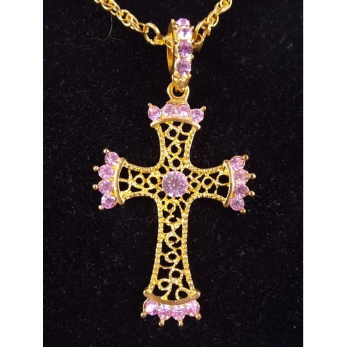 86 - Large gilt metal crucifix inlaid with pink stones & yellow metal chain...