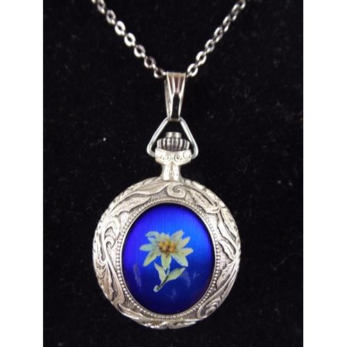 87 - White metal & enamel watch pendant on white metal chain, quartz movement...