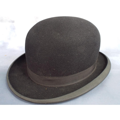 99 - Black Derby or bowler hat in excellent condition by Steeples of Nottingham, Leather headband inside...