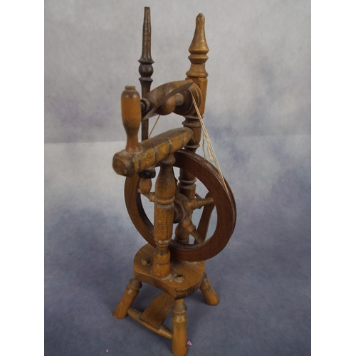 101 - Minature wooden spinning wheel in working condition...