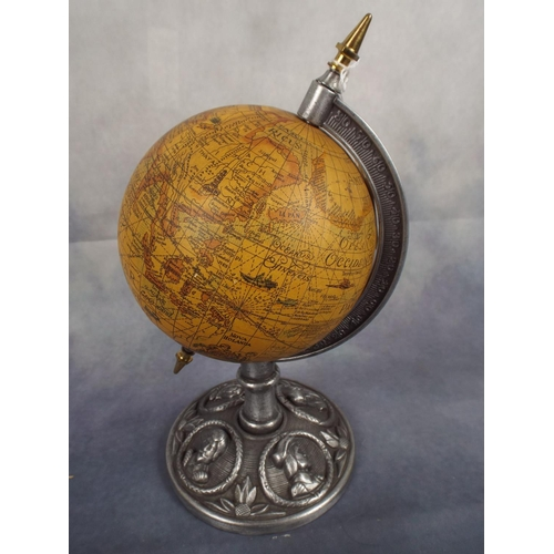 105 - Small Desk globe on metal stand with cameos inprinted to base...