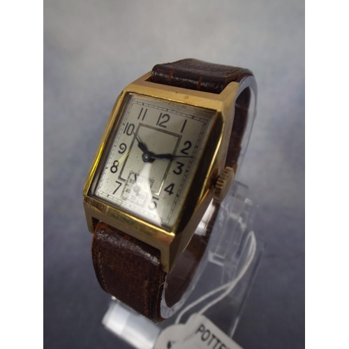 110 - Vintage tank watch with leather strap in working order. Rolled gold case...