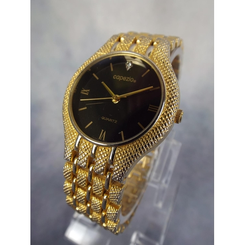 113 - Quartz watch with expanding gilt metal strap...