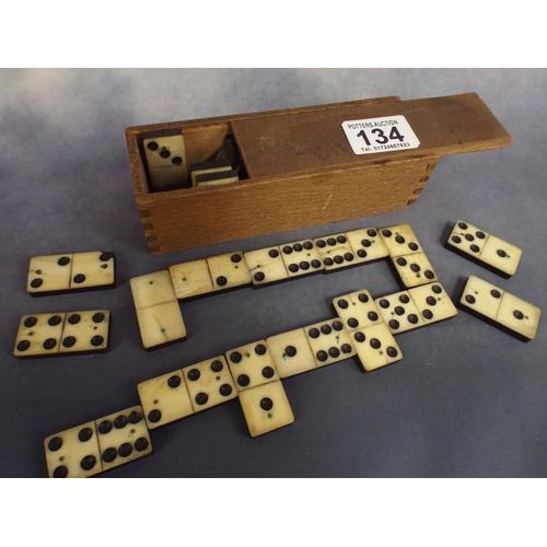134 - Box of wooden vintage dominoes...