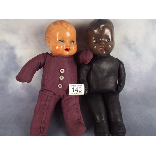 143 - Two vintage soft bodied dolls each with porcelain heads...