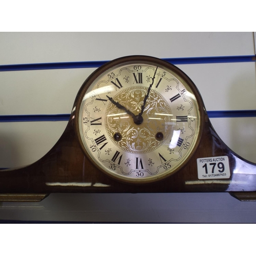 179 - Modern Mantle clock with ornate face, non runner for spares or repairs...