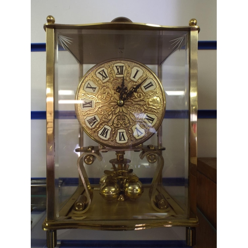 181 - Brass & glass cased anniversary clock in working order...