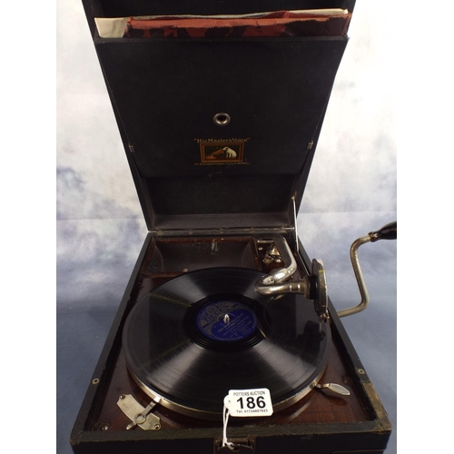 186 - Vintage 1920's/30's His Masters Voice wind up gramaphone with large selection of records, working or...