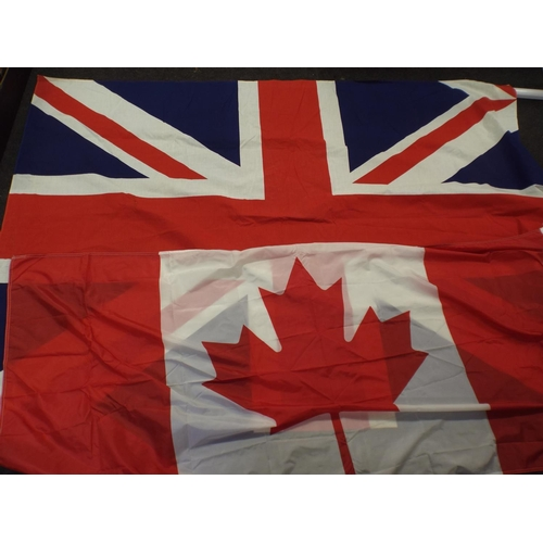 188 - Large 8ft X 4ft Union Jack Flag along with Canadian flag...