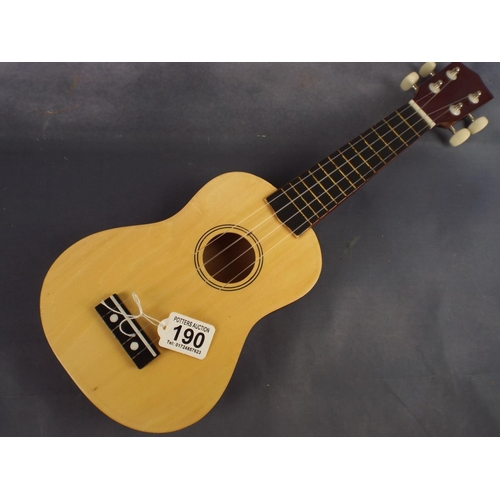 190 - small nylon strung ukulele with soft carrying case...