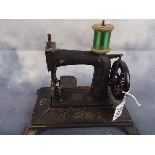 196 - Vintage cast iron childs sewing machine...