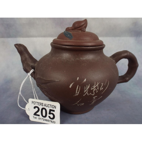 205 - Small terracotta chinese teapot with characters to base...