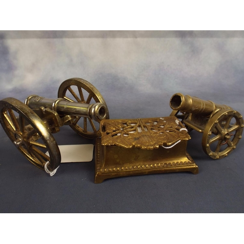 211 - Two small brass desk cannons with stamp box with pierced lid...