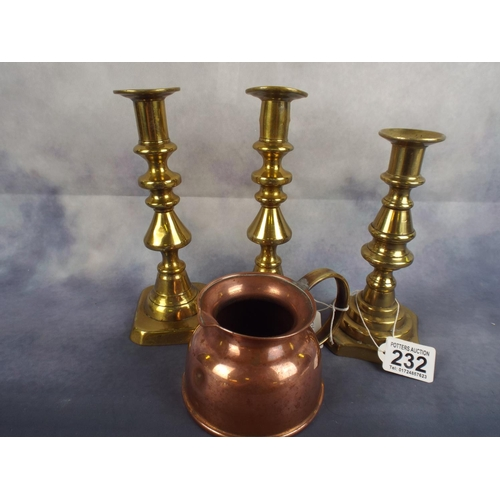 232 - Mixed lot comprising two brass candlesticks plus one other & Copper Cream jug with brass handle...