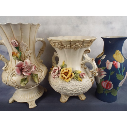 235 - Two large capo-di-monte urns with flowers applied together with bisque floral vase...