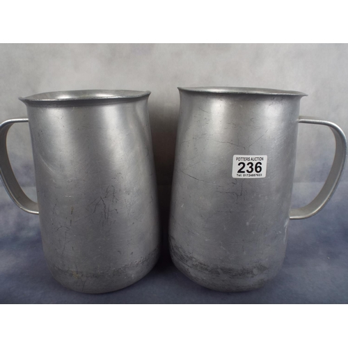 236 - Two large aluminium water jugs with handles...