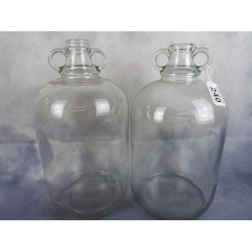 240 - Two large glass Demijohns...