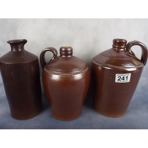 241 - three stoneware jugs in lustre finish...