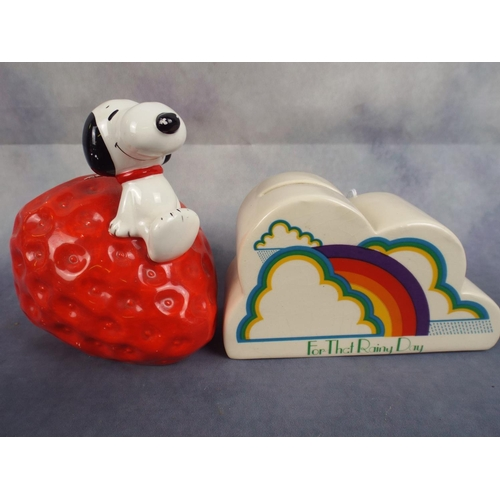 249 - Two money boxes, one art deco style , the other with snoopy sitting on a strawberry...