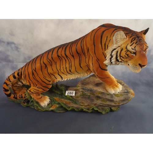 280 - Large resin figure of a tiger on a rock, 22 inches long...
