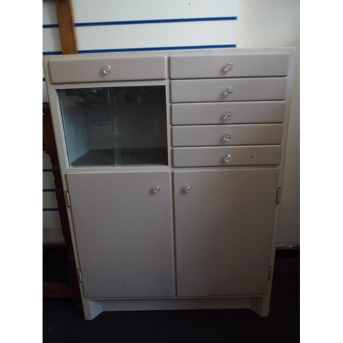 306 - Medical cabinet with six drawers and glass partition. Two doors under....