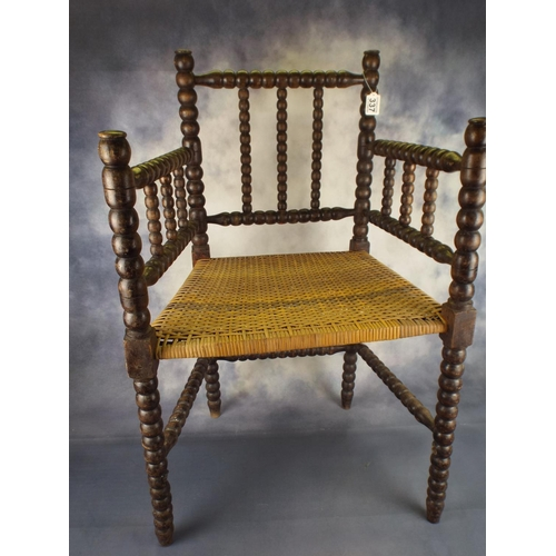 337 - Bobbin turned chair with dark wood with rush seat...