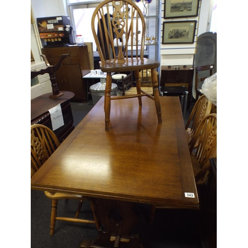 342 - Extending oak dining table & 4 wheel back chairs...