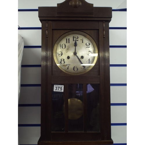 375 - Mechanical wall clock in dark oak case, good working order...