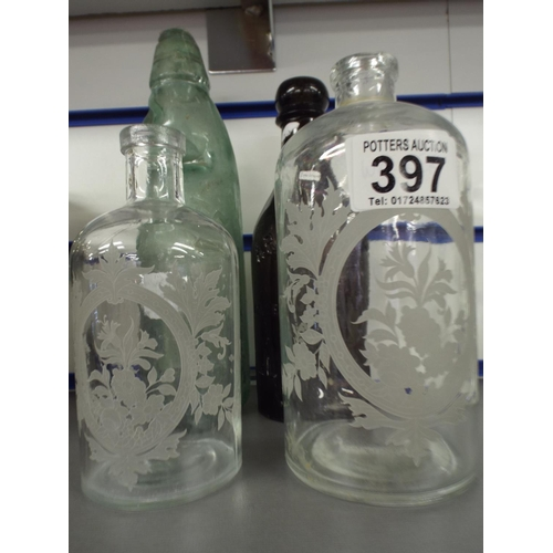 397 - Four vintage bottles,  2 etched...