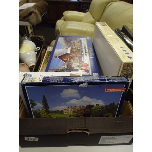 476 - Large box of puzzles...