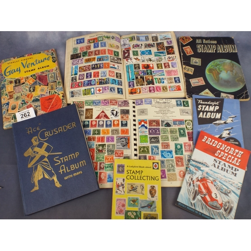 262 - Seven Stamp albums with contents & ladybird book of stamp collecting...