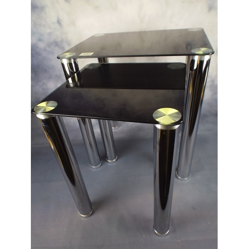 345 - Two smoke glass & chrome stacking tables...