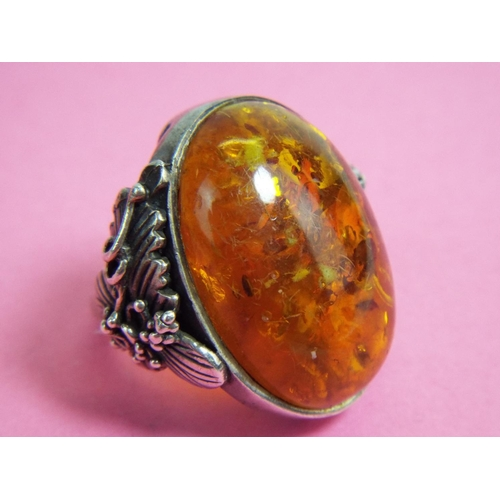 48 - Very large amber set ring.  Finger size 'R5'...
