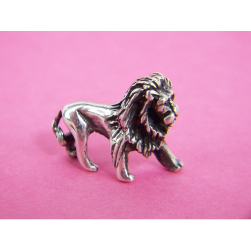 55 - 925 solid silver Lion.  Just over half an inch long....