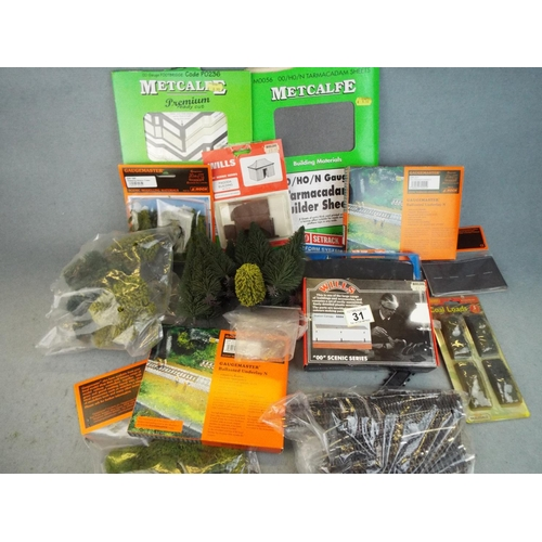 31 - Selection of 00 gauge trackside accessories. Plus some N gauge track....