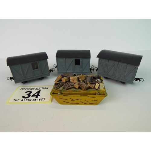 34 - Thee 'N gauge' covered wagons plus model skip & contents....