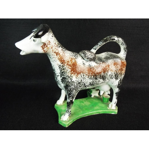 22 - 19th Cent Staffordshire cow creamer....