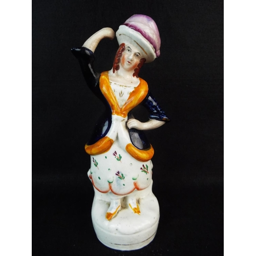 24 - 19th Cent staffordshire figurine. 8 inches tall....
