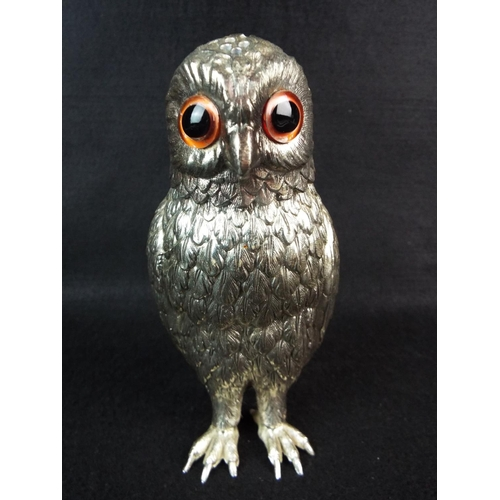 26 - White metal pepperette as an owl with orange glass eyes. 5.5 inches tall....