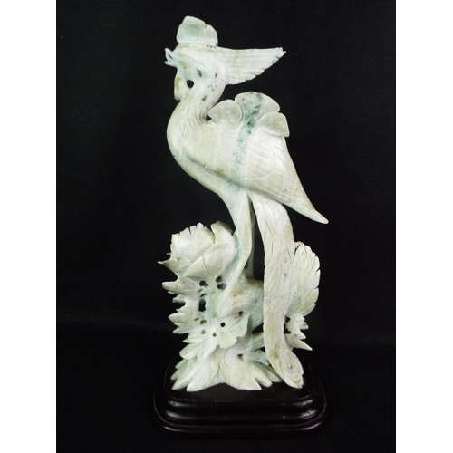 30 - Large carved chinese Jade figure of a bird with flower. Ebonised wooden base. 12.5 inches tall....