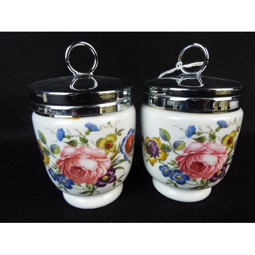 36 - Pair of large Royal Worcester, Double egg sized coddlers. Painted floral pattern....