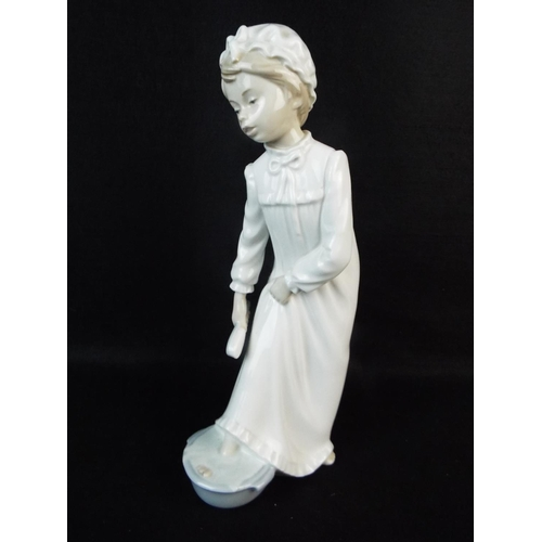 52 - Large Nao figurine of a little girl washing her feet. 11 inches tall....