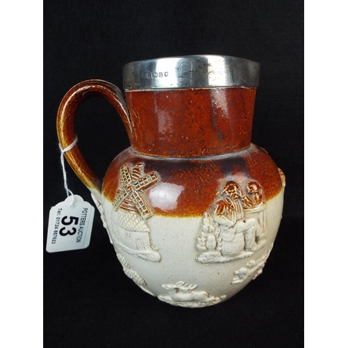 53 - Royal Doulton Stoneware cider jug with hallmarked silver rim. Birmingham 1865...